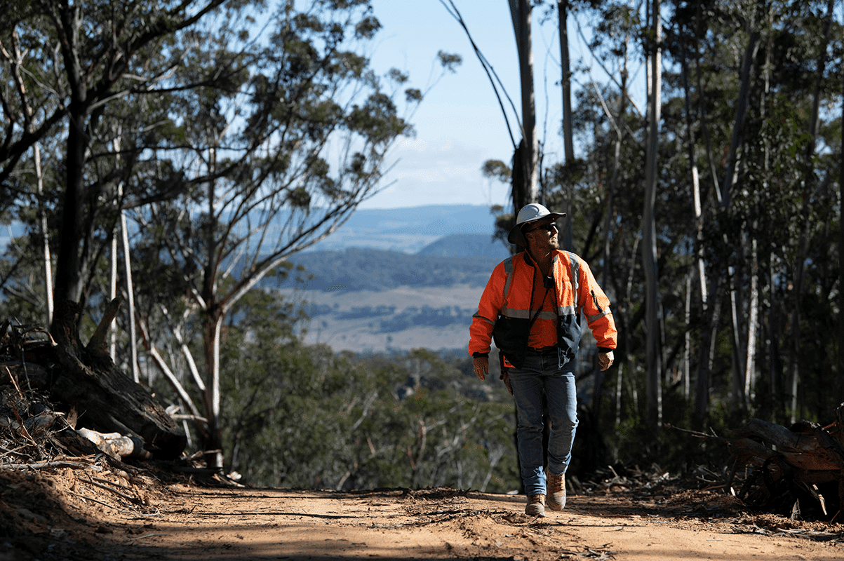 Zac Simpson walking along a fire trail at the Springvale site