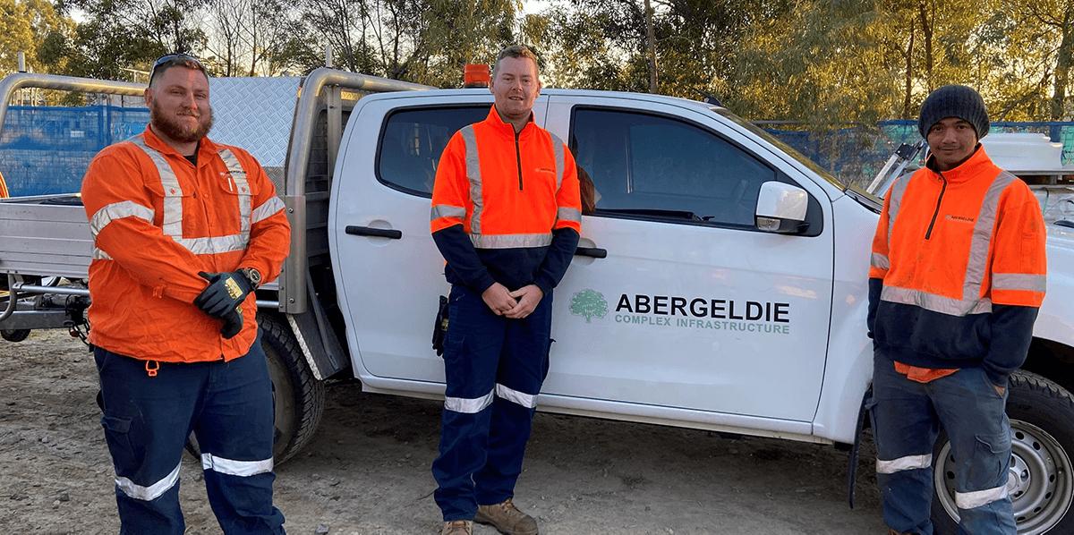 Three men in front of an Abergeldie ute