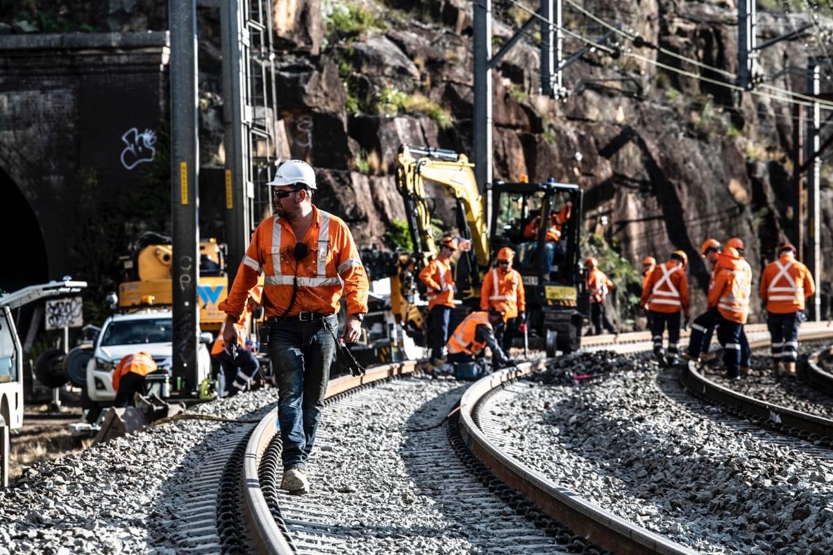Abergeldie staff walking on rail during possession