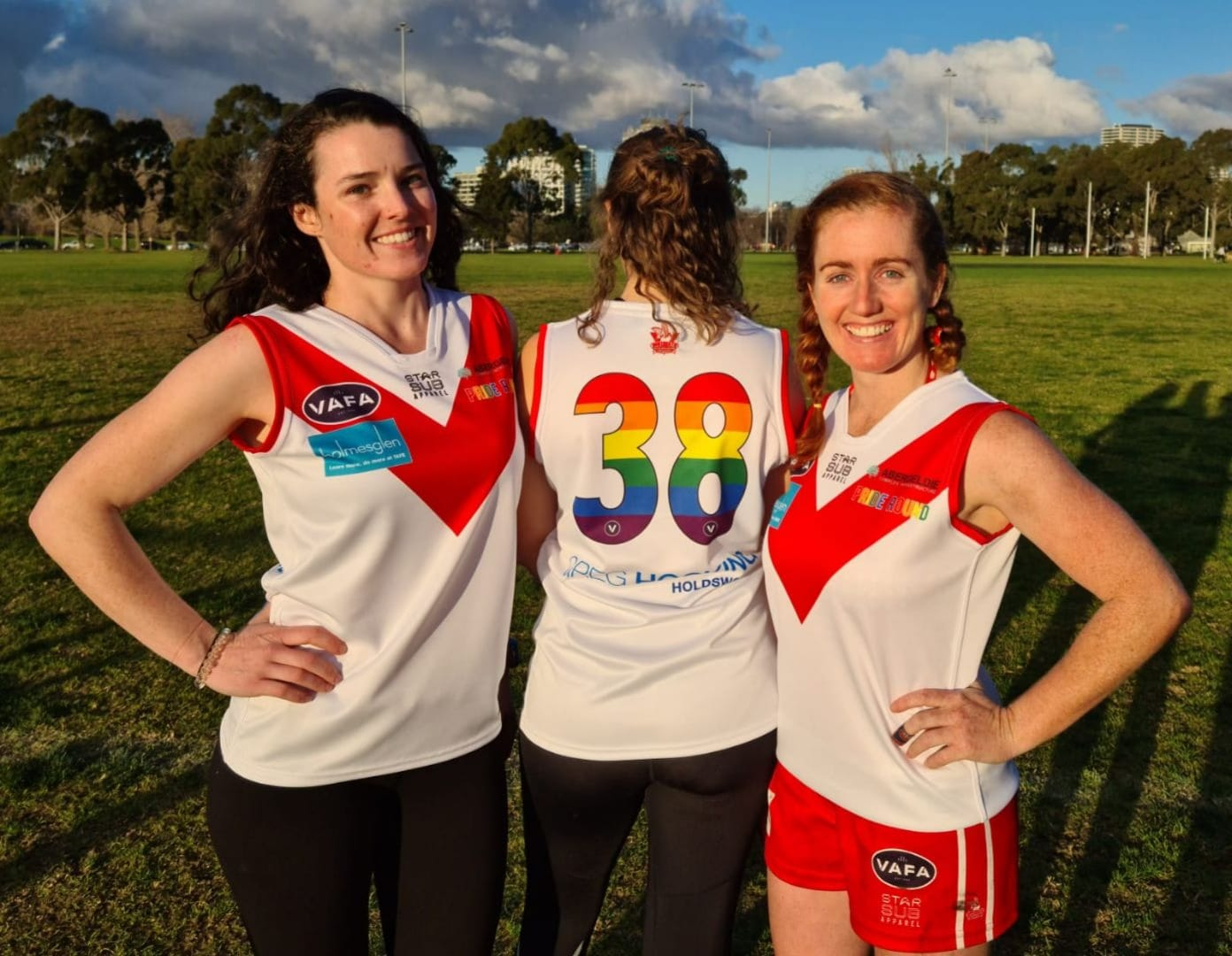 Women of the SMDF Team posing with their new rainbow team shirts
