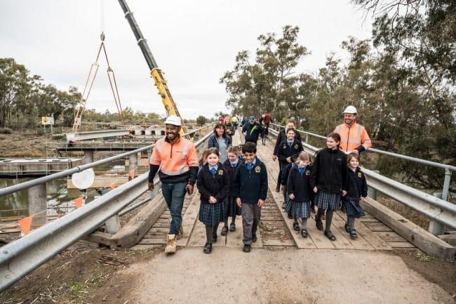 Abergeldie staff and Children walking on Matthewes Bridge