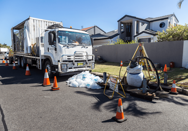Photo of a relining truck next to a residential area where they are rehabilitating the stormwater
