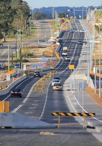 Cars driving along Schofields Road